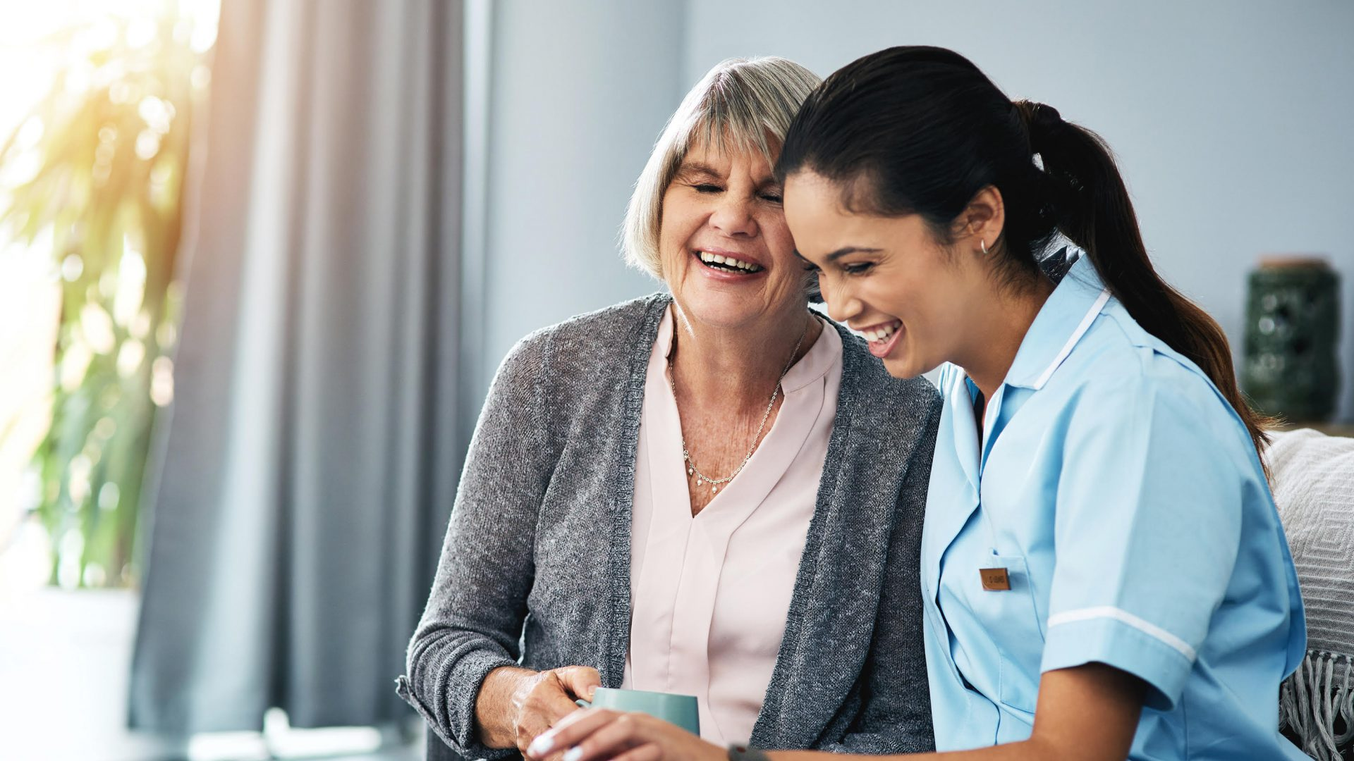Caregiver speaking with a senior resident