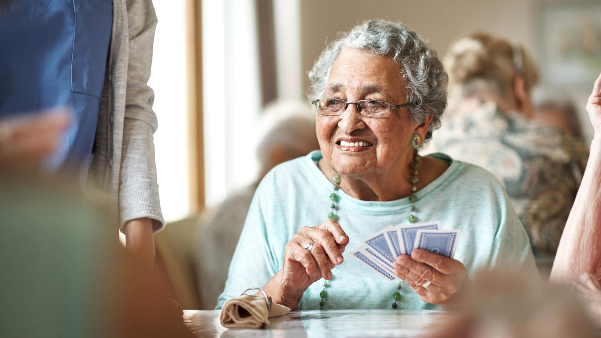 senior lady playing cards